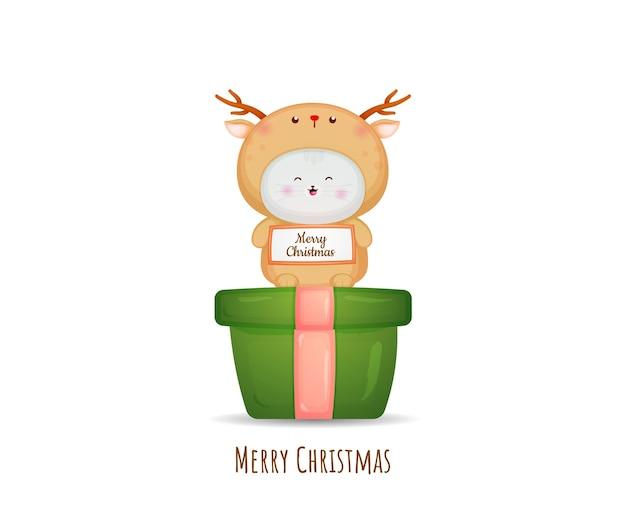 메리 크리스마스 카드 그림에 대 한 사슴 의상에서 귀여운 키티 premium 벡터