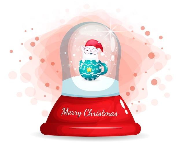 Милая кошечка с чашкой в стеклянном колпаке на рождество