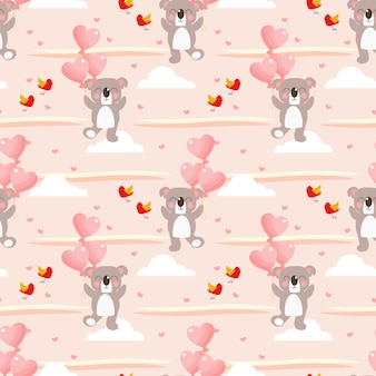 かわいいコアラとハート型のバルーンのシームレスパターン。