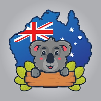 Cute koala brought a wooden board and leaves with australia background