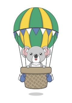 Cute koala character riding hot air balloon