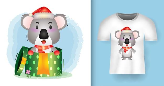 티셔츠 디자인으로 선물 상자에 산타 모자와 스카프를 사용하는 귀여운 코알라 크리스마스 캐릭터