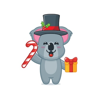 Cute koala holding christmas candy and gift cute christmas cartoon illustration