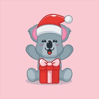 Cute koala with christmas gift cute christmas cartoon illustration