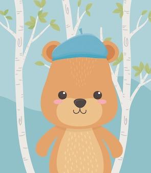 Cute and little bear teddy in the field