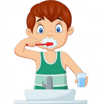 Cute little boy brushing teeth
