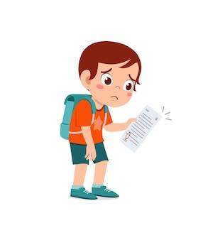 Cute little boy feel sad because get bad grade from exam