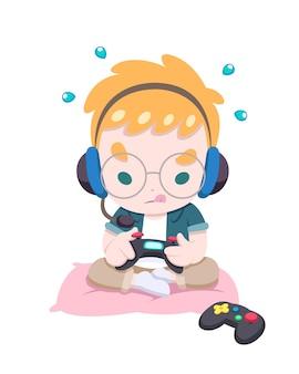 집중적으로 조이스틱으로 게임을하는 귀여운 소년 게이머