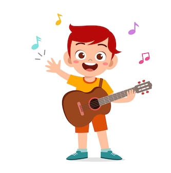 Милый маленький мальчик играет на гитаре на концерте