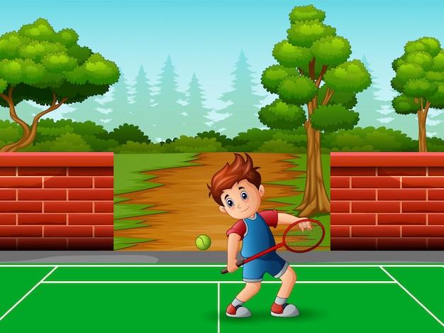 A cute little boy playing tennis