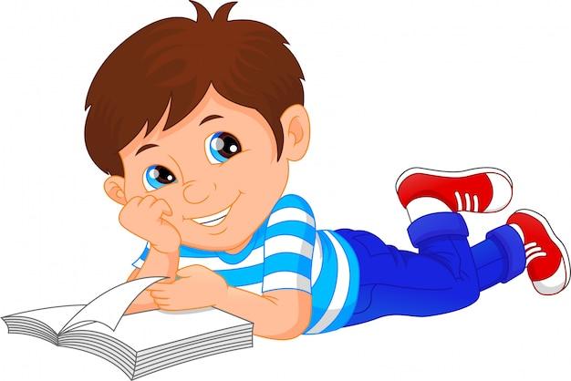 Cute little boy reading book