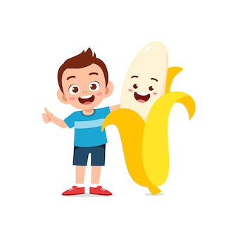 Cute little boy stands with banana character