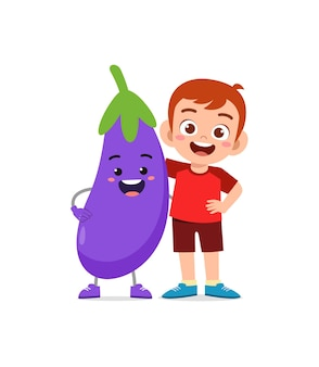 Cute little boy stands with eggplant character