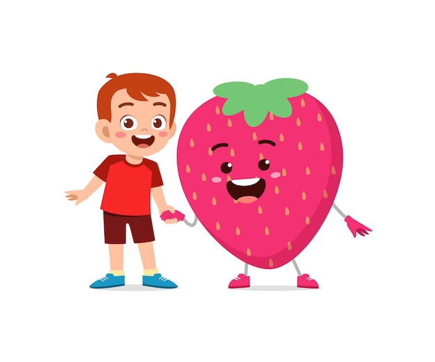 Cute little boy stands with strawberry character