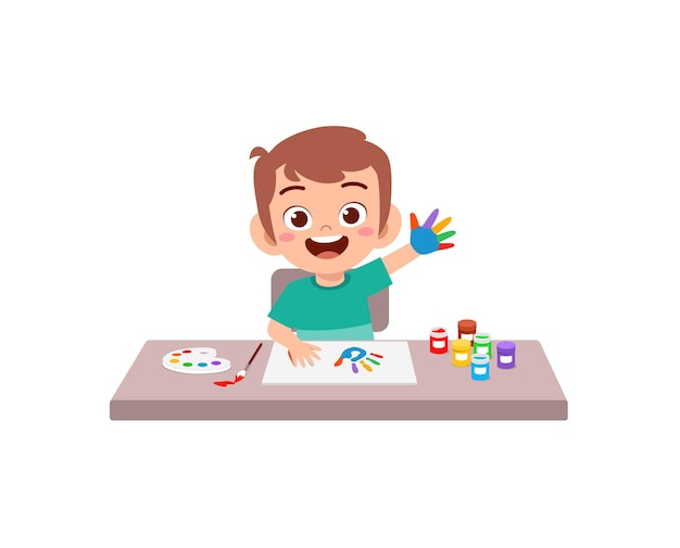 Cute little boy using paint to hand for art