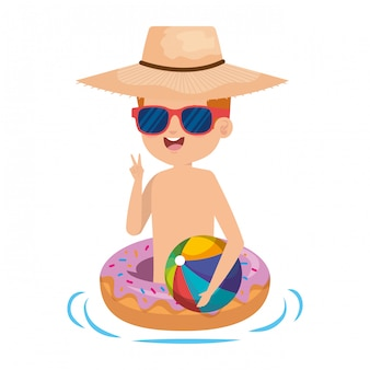 Cute little boy with donut float and beach balloon