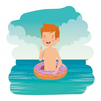 Cute little boy with swimsuit and donut float on the sea