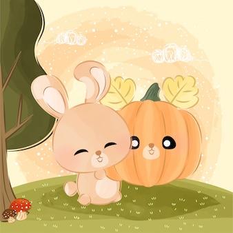 Cute little bunny carrying pumpkin