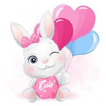 バルーンを保持しているかわいいウサギ