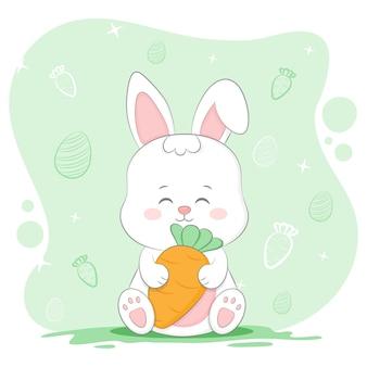 Милый маленький кролик держит морковку