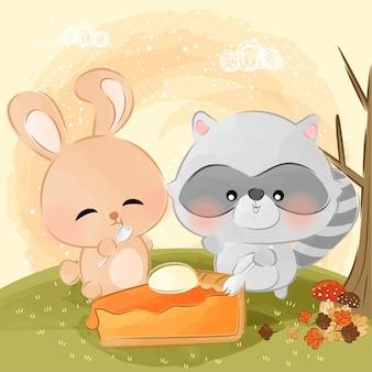 Cute little bunny and raccoon eats pumpkin pie