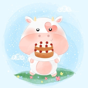 Cute little cow holding cake