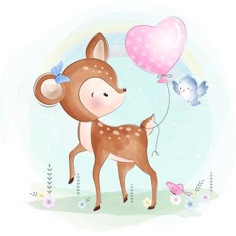 Cute little deer playing with bird