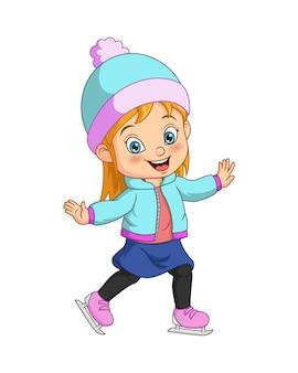 Милая маленькая девочка в зимней одежде играет на коньках