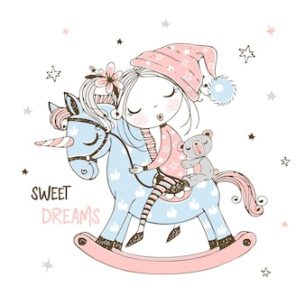 A cute little girl is sleeping sweetly on a unicorn toy horse.