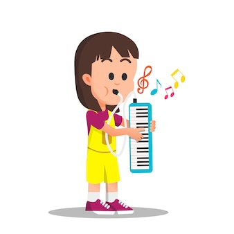 A cute little girl playing melodica instrument