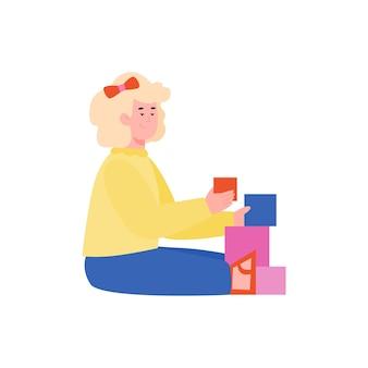 床に座っておもちゃのブロックを遊んでいるかわいい女の子、白い背景で隔離の漫画フラットベクトルイラスト。早期教育と知的発達。