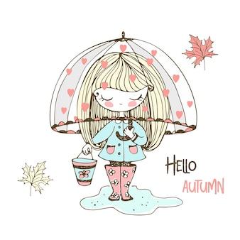 A cute little girl in rubber boots walks through puddles under an umbrella.