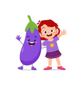 Cute little girl stands with eggplant character