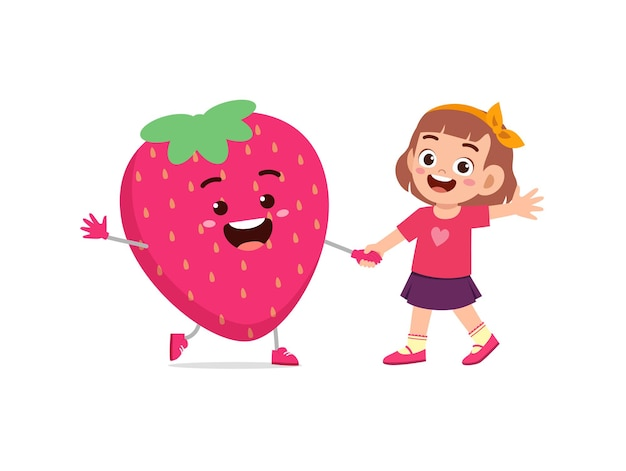 Cute little girl stands with strawberry character