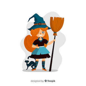 Cute little girl witch with a kitten and broom
