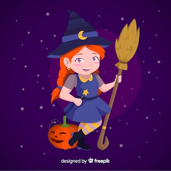 Cute little girl witch with a pumpkin