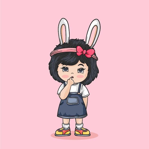 Милая маленькая девочка с красной лентой и кроличьими ушками