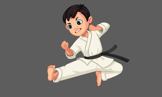 Милый маленький мальчик каратэ в позе каратэ 2