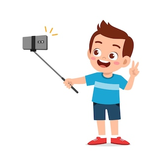 Cute little kid boy pose and selfie in front of camera
