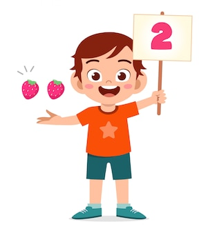 Cute little kid boy study math number count fruit