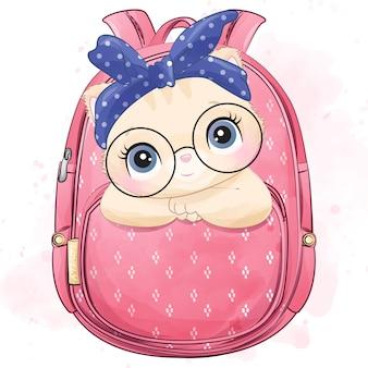 가방 안에 앉아 귀여운 작은 키티