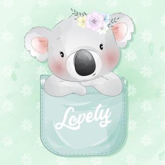 Cute little koala bear sitting inside a pocket