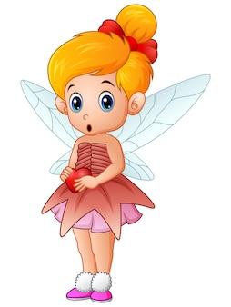 Cute little love fairy holding a heart