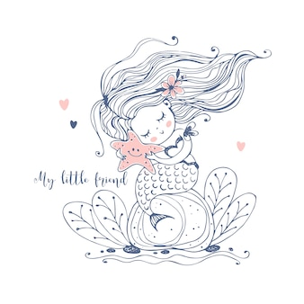 A cute little mermaid sits on a rock and holds a starfish in her hands.