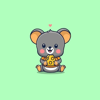 Cute little mouse eating cheese isolated on green