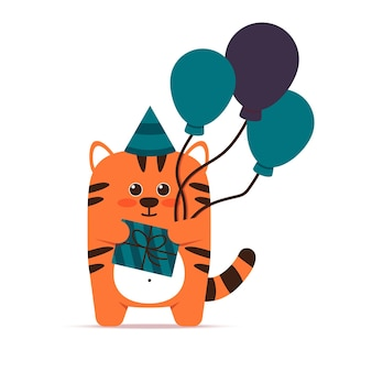 Cute little orange tiger cat in a flat style. an animal with balloons is standing with a gift in a box and a cap. happy birthday and holiday greetings. for banner, nursery, decor. vector illustration.