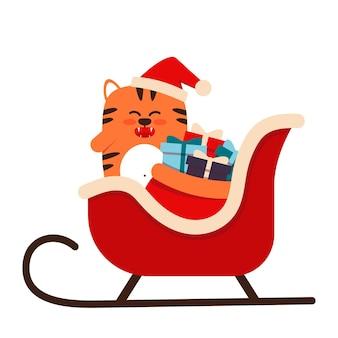 フラットスタイルのかわいい小さなオレンジ色のトラ猫。 2022年の旧正月のシンボル。そりにプレゼントが付いたクリスマスキャップの動物。バナー、保育園の装飾に。ベクトルイラスト。