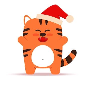 フラットスタイルのかわいい小さなオレンジ色のトラ猫。 2022年の旧正月のシンボル。クリスマスの帽子をかぶった動物。うれしそうな虎が立っています。バナー、保育園の装飾に。ベクトルイラスト。