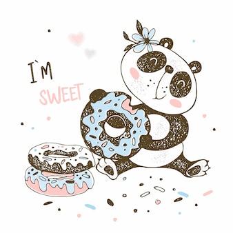 Cute little panda eats sweet donuts.