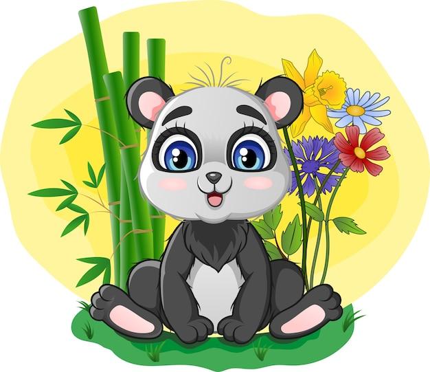 草の中に座っているかわいいパンダ